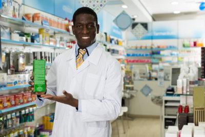 male pharmacist proposing medicines drug in pharmacy