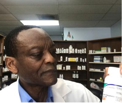 pharmacist examining prescriptions